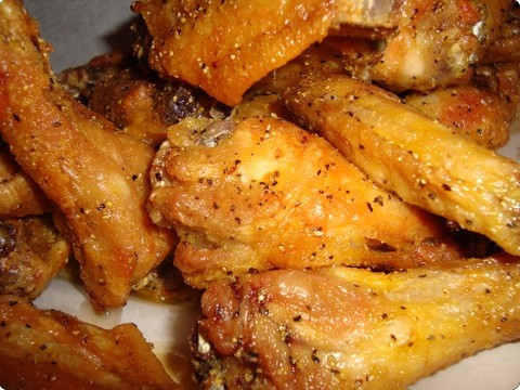 WINGSTOP COPY CAT LEMON GARLIC PEPPER WINGS -  2 lbs. chicken wings 1/2 c. lemon juice 1 whole garlic clove (4 slices chopped) 1 tbsp. pepper 2 tbsp. salt 1/4 c. vegetable oil  Place wings in bowl; pour on lemon juice, garlic and pepper. Sprinkle salt and pout oil; stir. Marinate for 2 hours at room temperature, stirring occasionally to keep coated. Wings may be barbecued or placed in saucepan and baked 20 to 30 minutes, basting occasionally.