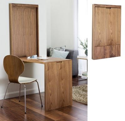The ultimate in smart storage of a dining table! This walnut dining table turns in to a wall panel when not in use $249