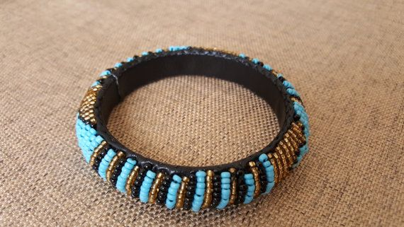 Check out this item in my Etsy shop https://www.etsy.com/listing/504700805/beaded-bangle-ethnic-leather-beaded