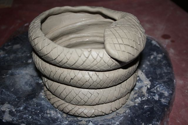 Clay snake candle holder