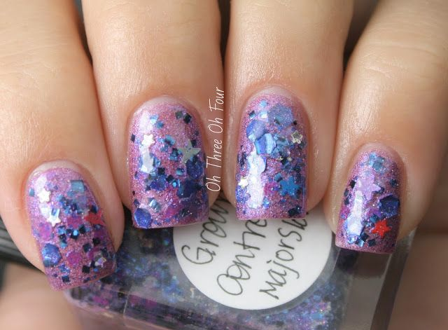 Ground Control to Major Sloth contains royal blue squares and hexes, baby stars, neon blue and purple hexes, and a dash of star glitters in various colors all in a shimmery blue-purple base Here is 2 coats of Ground Control to Major Sloth over 2 coats of Avon Aurora.