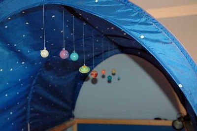 Okay... I'll wait for him to be a toddler, at least; but this IKEA hack for a planetarium in the KURA bed tent is genius.