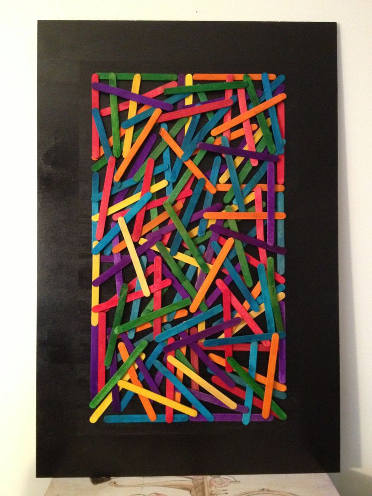 Colorful Popsicle Wall Art  Paint the Popsicle sticks and fix them haphazardly all across the board, to create a majestic wall art. Frame the entire thing when you are done, to lend a neat and an organized look to it.