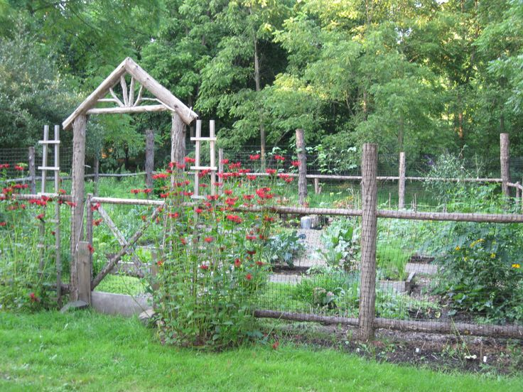 Vegetable garden surrounded by a split rail fence to keep the rabbits and dear away.