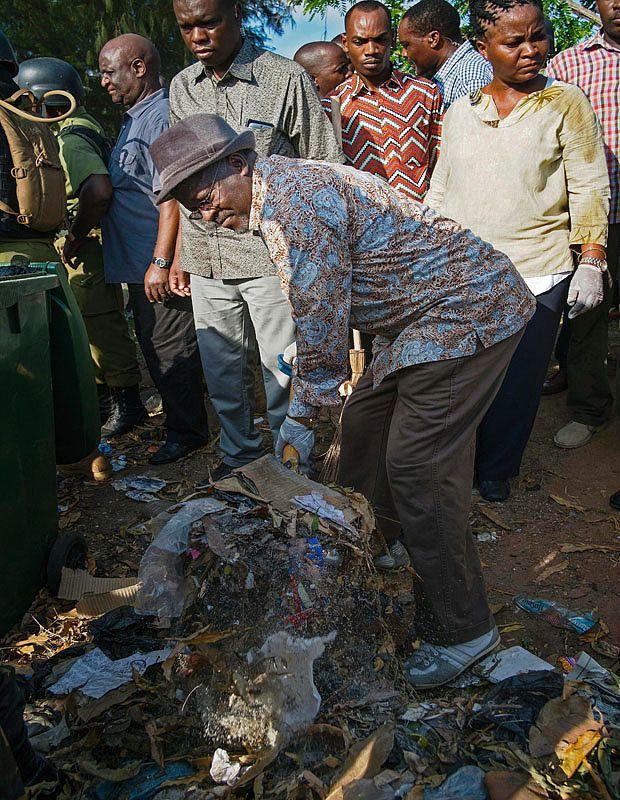 Tanzania president John Magufuli helps sweep the streets outside state palace - Telegraph