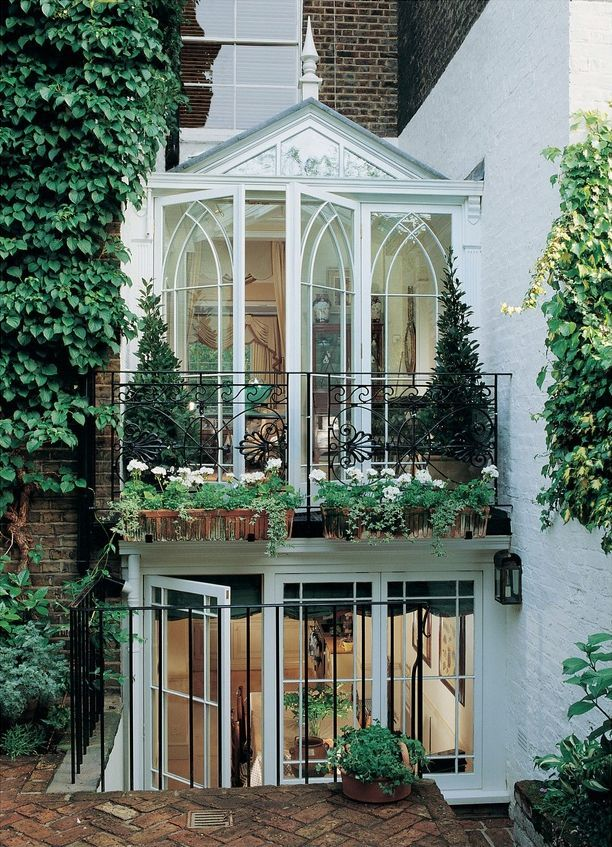 A two-story conservatory behind a London townhouse by Peter Marston and Adrian Langinger