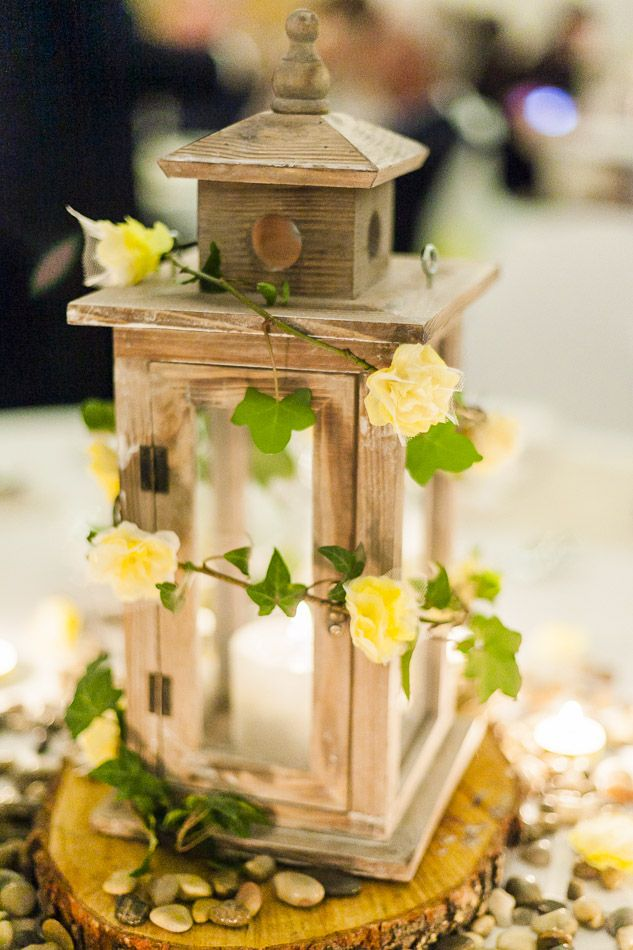 Centrepiece- Lanterns, Ivy and paper flowers