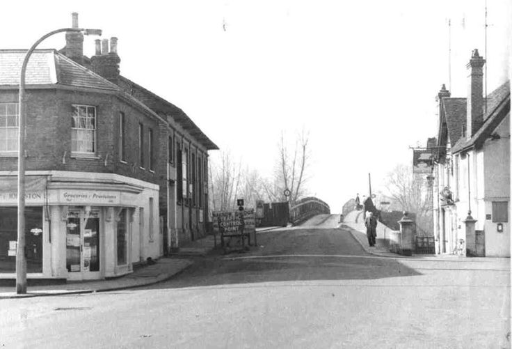 St. Neots Town Bridge from the Market square with Dudeney & Johnson Grocers (left) the Public Rooms (beyond grocers) and the Bridge Hotel (right) in 1962/63