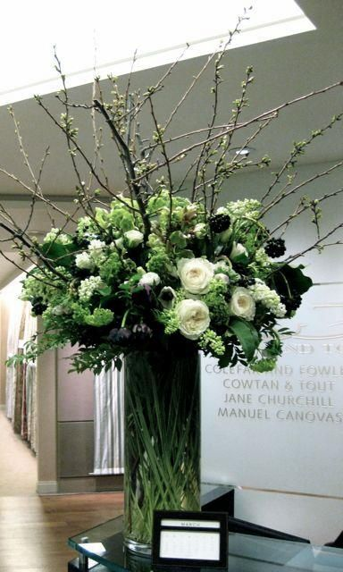 BEAUTIFUL TWIGS AND WHITE FLOWERS IS A TALL GLASS VASE.. SO NICE FOR DINING ROOMS!!!