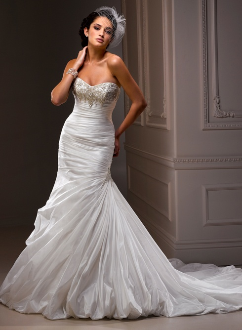 The dress, minus the pick-ups added to the bottom of the skirt.    Maggie Sottero  Megan's dress is ivory