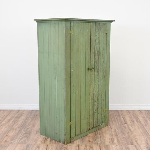 This rustic antique armoire is featured in a solid wood painted in a distressed shabby chic light green finish. This large cabinet is in great condition with wood slats, 2 doors and a large interior with shelving. Vintage storage piece perfect for storing linens!·Dimensions: 36x19x55   ·Condition: Very good   ·Material: Wood   ·Number_of_pieces: 1   Available now on Loveseat.