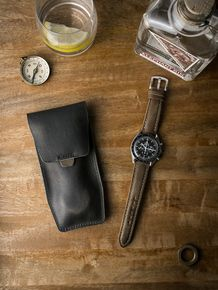 """Bas and Lokes army green """"Kingsford"""" handcrafted leather watch pouch. Next to it is a scrumptious vintage Omega Speemaster paired with our tan """"Bahrain"""" handcrafted leather watch strap. Pouch and strap are both available at www.basandlokes.com"""