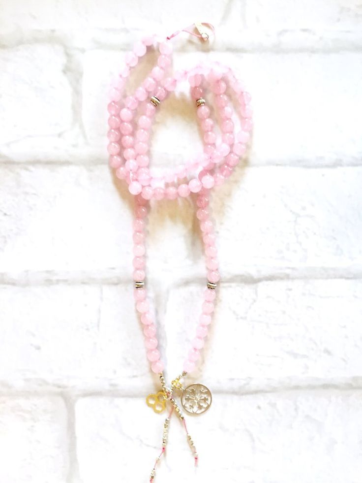 Rose Quartz Mala Necklace Intentional jewelry made with rose quartz gemstones and sacred geometry pendents. Used during meditation, yoga practice or simply worn as a beautiful piece of jewelry. Each gemstone hold unique healing properties and can be used as a daily reminder of your positive intentions.