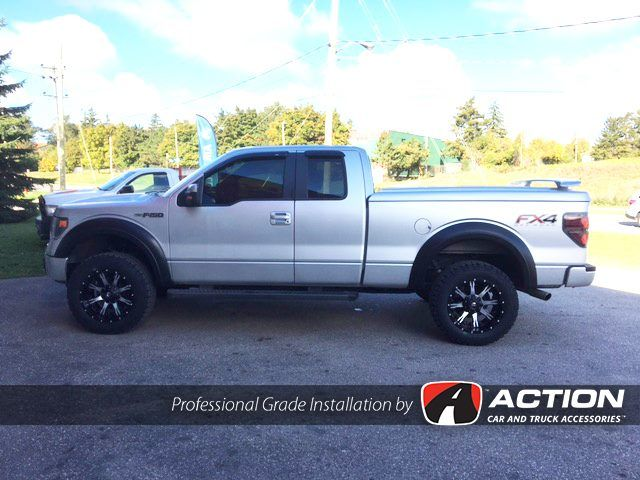"""2013 Ford F150 - AVS Vent Visors - Bushwacker Extend-a-flares - Dual 2.5"""" Exhaust by MBRP Performance Exhaust - BFGoodrich TA KO2 305/55r20 tires - Fuel """"Nutz"""" 20x10 Wheels - LSII Fiberglass tonneau cover with wing by A.R.E. Truck Caps and Tonneau Covers - 2"""" Front, 3"""" Rear lift by ReadyLift Suspension Inc. - B-light battery powered LED bed light by TruXedo Tonneau Covers #ProfessionalGradeInstallation"""