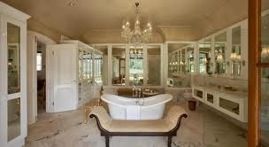 So Victorian! Marble floors and an arched ceiling! Mirrors everywhere! #chandelier #bathroom #tiles #vanity