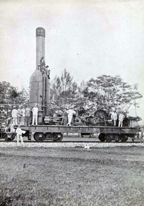 A piece of machinery is transported by rail Bandung 1900 - 1945