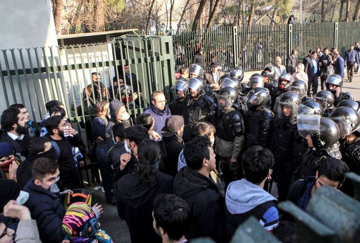 IRAN:  Iran lawmaker says 3,700 arrested in days of protest, unrest  - January 9, 2018.  FILE- In this Dec. 30, 2017 file photo taken by an individual not employed by the Associated Press and obtained by the AP outside Iran, anti-riot Iranian police prevent university students to join other protesters over Iran weak economy, in Tehran, Iran. New unrest in Iran over the past 10 days appears to be waning, but anger over the economy persists. The protests in...