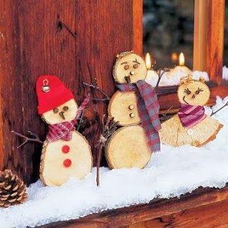 creatief besparen en meer: sneeuwpop van houten schijven