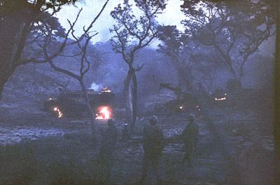Просмотр изображений The late evening of November 16th, 1987. South African military vehicles burn after being attacked. This a Color Positive photograph taken somewhere in the vicinity of the Lomba River during The Battle of Cuito Cuanavale.