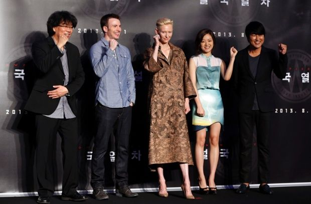 (L to R): Director Bong Joon-ho and cast members Chris Evans, Tilda Swinton, Ko Asung and Song Kang-ho promote the film Snowpiercer at a hotel in Seoul.
