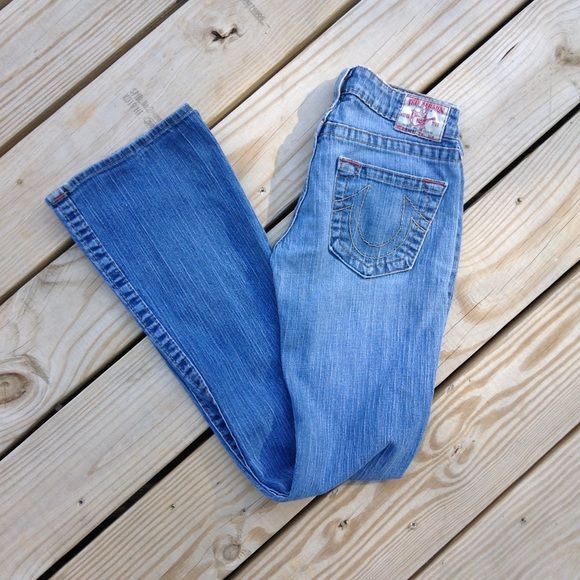 TRUE RELIGION JEANS SIZE 27 Cute true religion Jeans. Some wear to the back patch and hole at bottom of leg. Would be cute rolled or with a patch. Can be sewn. Still have lots of life left. True Religion Jeans