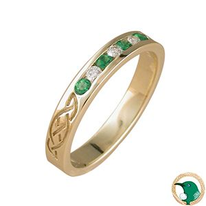 Our 18ct yellow gold ring with four 2mm round emeralds (TW .13ct) and three .03ct round channel set diamonds (TDW .09ct). G colour, SI1 clarity.   x4 engraved Celtic designs appear around the outside of this Celtic ring.