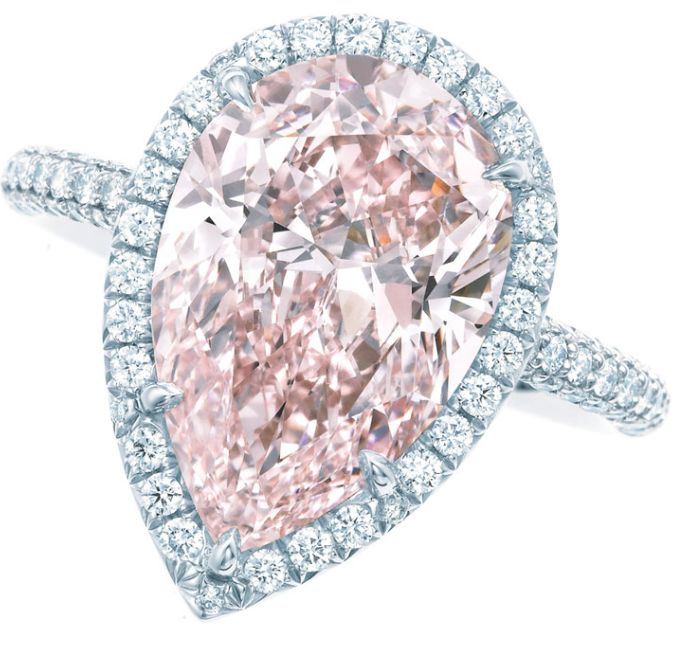 Pink diamond and diamond ring by Tiffany and Co. A pear-shaped 2.11ct fancy intense pink diamond, surrounded by a single row of white diamonds