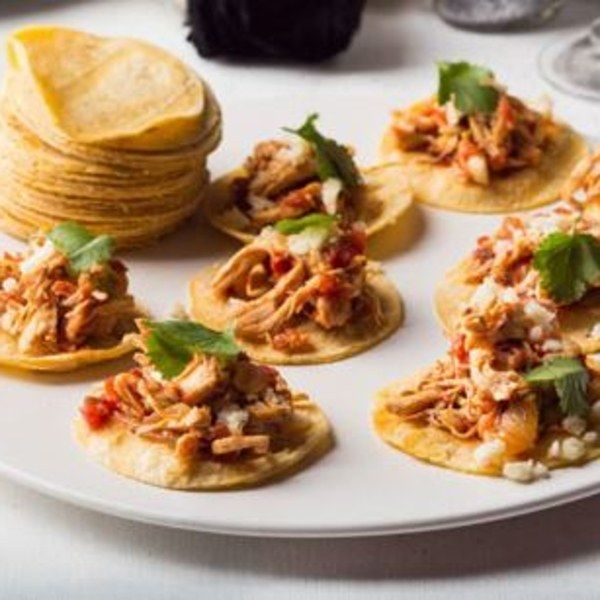 Don't say we didn't warn you! These hors d'oeuvre–size soft tacos will be gobbled up faster than you can say tinga de pollo. But no need to fear, because the recipe is easily doubled, which means you'll be tasting and toasting until the clock strikes midnight.                  Editor's Note: This recipe is part of Gourmet's Modern Menu for A New Years' Eve Pasrty. Menu also includes Turkish Spiced Meatballs with Pomegranate Yogurt Sauce          and Parmesan Pepper Curly Kale Chips         .