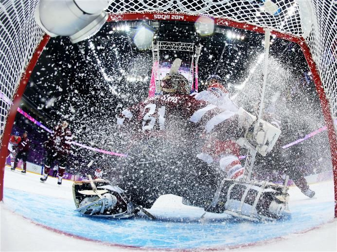 Michael Frolik #67 of Czech Republic stops in front of Edgars Masalskis #31 of Latvia in the first period during the Men's Ice Hockey Prelim...