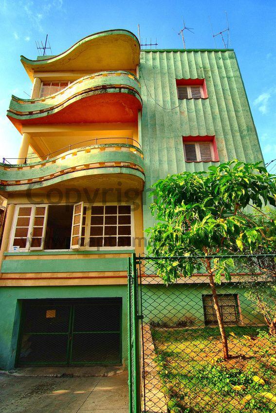 Orange? - Art Deco, Casa, Havana, Cuba I love the balconies they remind me of pianos.