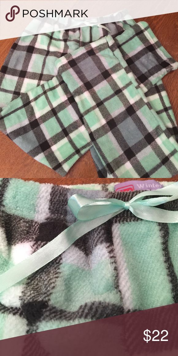 Fleece pajama bottoms size small green plaid These fleece pajama bottoms are super soft and fluffy with an elasticized waist and a tie at the waist and adorable plaid print with black cream and green.   SZ S      100% polyester Intimates & Sleepwear Pajamas