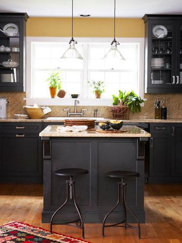 Black cabinetry looks great with yellow walls. #kitchen #decoratingideas