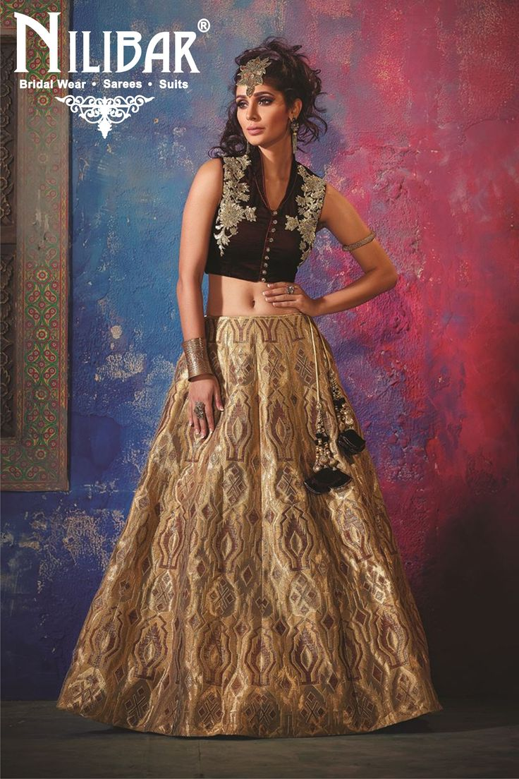 #https://www.facebook.com/nilibarworld #https://www.instagram.com/nilibarludhiana/?hl=en #https://twitter.com/nilibaronline #https://in.pinterest.com/nilibar/  #Get a regal look in this urbane lehenga choli set featuring a gold brocade lehenga bearing self fabric designs along with the choli crafted from wine velvet, worked with sequins, zari & katdana buttas over both sides with buttons at the front for show! This lehenga choli set is accompanied with matching dupatta.