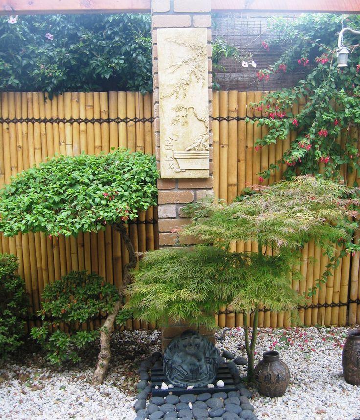 2009 Buddha, wisteria plaque and Japanese maple tree
