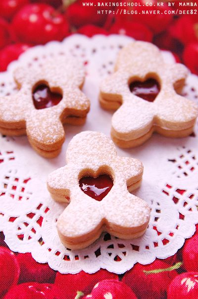 Linzer Cookies with Raspberry Jam.  These would be super cute with a heart in hand cookie cutter, too! #holidays #christmas #recipes