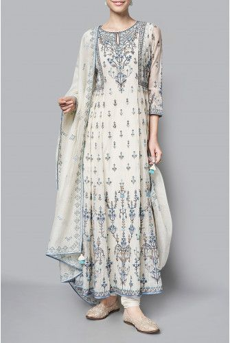 The natural hued chanderi mull suit is embroidered with floral motifs that remind you of lush beautiful gardens of summer. The Kaarvi kurta, paired with a churidar and embroidered dupatta, is the perfect addition to your summer wardrobe. Fabric:Chanderi Mull Content:70% COTTON / 30% SILK Production time:We require 6-7 weeks to dispatch this outfit