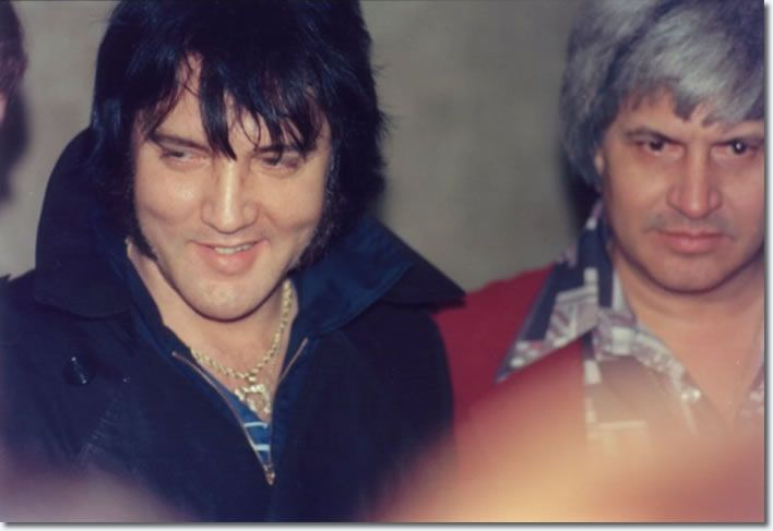 Elvis arriving from Orlando, FL in the hotel lobby in Montgomery, AL with Ed Parker on Tuesday, February 15, 1977. Elvis had a concert at Garrett Coliseum in Montgomery on the 16th. Photo © Keith Alverson