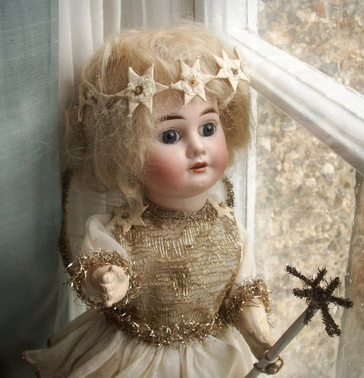 Antique bisque Christmas doll
