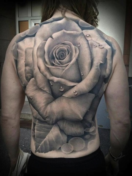 rose back tattoo (VERY large rose but awesome black and gray. very detailed, love it)