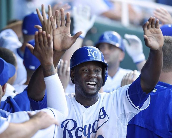 Kansas City Royals' Lorenzo Cain (6) celebrates scoring on a home run by designated hitter Kendrys Morales (25) in the fifth inning during Saturday's baseball game against the Boston Red Sox on June 20, 2015 at Kauffman Stadium in Kansas City, Mo.