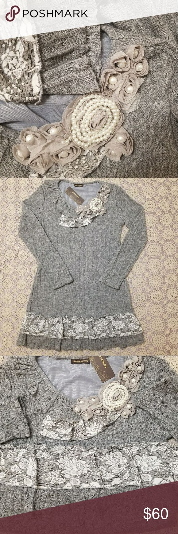"""Wool Blend sweater dress/ tunic BOHO Chic style. NWT! Wool Blend sweater dress from John Fashion. Dress is in Boho Chic style, in gray colroing with different textures mixed in. Ruffle, pearl , floral detailing. Very pretty! Measurements taken while laying down flat with no stretching: Chest (armpit to armpit side to side) 17.5"""" Length (top of the shoulder down to the bottom) 33"""" Sleeve length (measured from place where stitched in down to the cuff) 23"""" No defects. Smoke free and pet free…"""