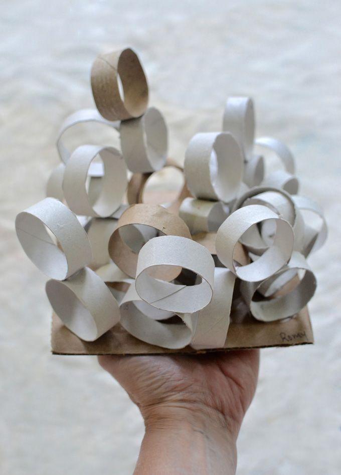 Kids make sculptures from cut up cardboard tubes.