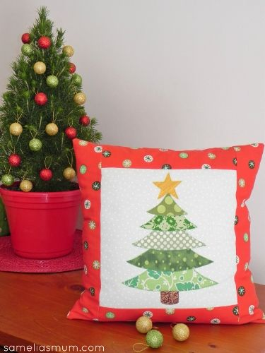 Use your green scraps to make this Christmas tree appliqué cushion. Template diagrams here https://docs.google.com/file/d/0BwxfkdlxQa0JeF9QNzdNTkpWakk/edit
