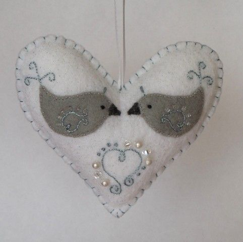 This adorable felt heart ornament was hand-stitched, appliqued, & embroidered