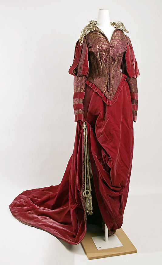 Haute Couture Victorian fashion fancy dress costume gown from 1890, American, 19th century. Made from silk woven, velvet and metalic trim. Lace collar with long sleeve design creates a decorative effect emphasizes the bodice and waistline. Dress skirt fully flared with train at the back. #Vintage #Victorian #Fashion