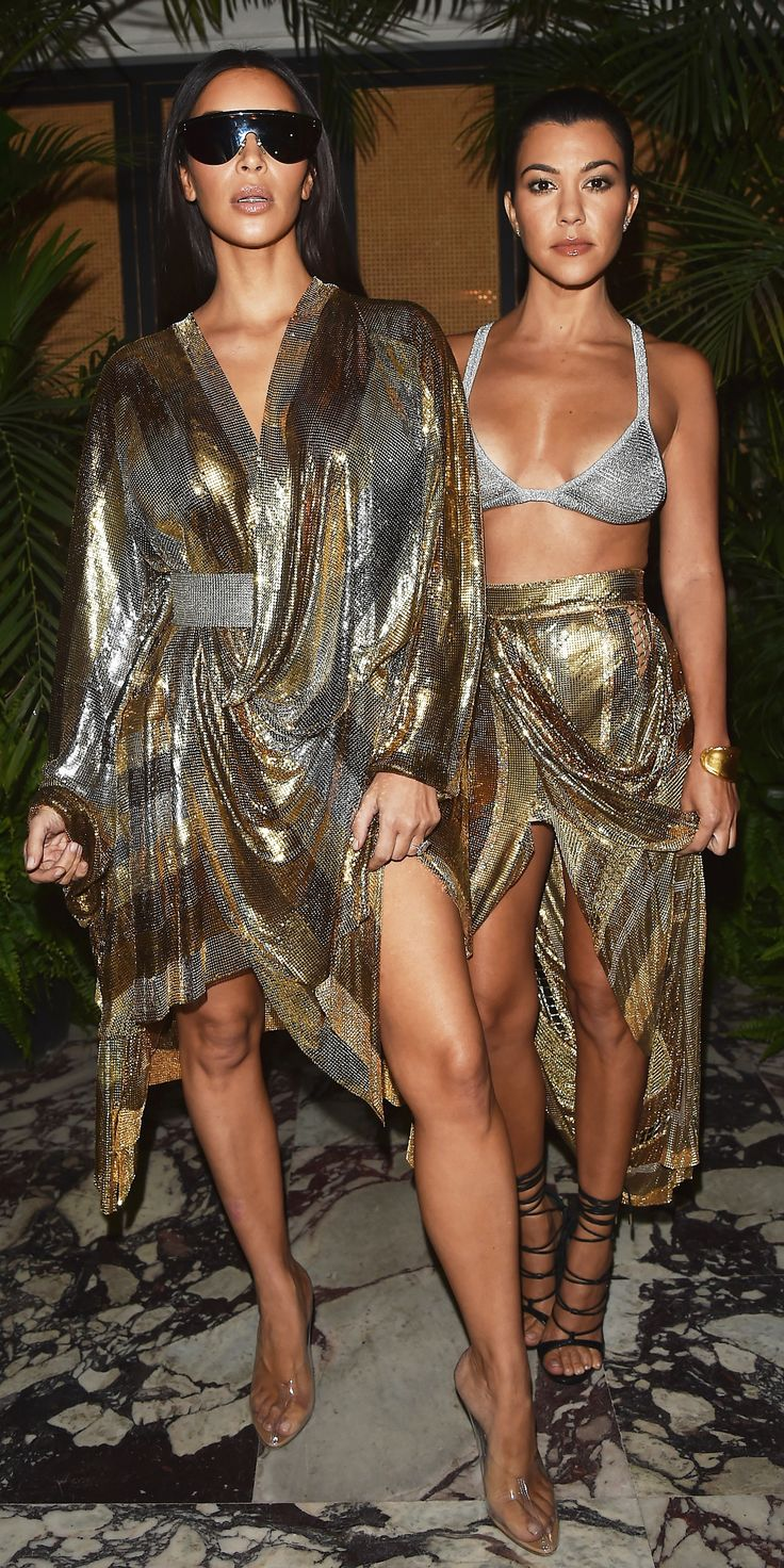 Kourtney and Kim Kardashian continued their Paris Fashion Week domination Thursday night when they stepped out in coordinating metallic ensembles for Balmain's after-party.