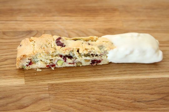 Cranberry pistachio biscotti dipped in white chocolate. MM!