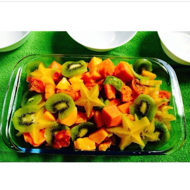 Fruit salad for a sunny morning (or whenever): Kiwi, star fruit, papaya, mango, and figs.