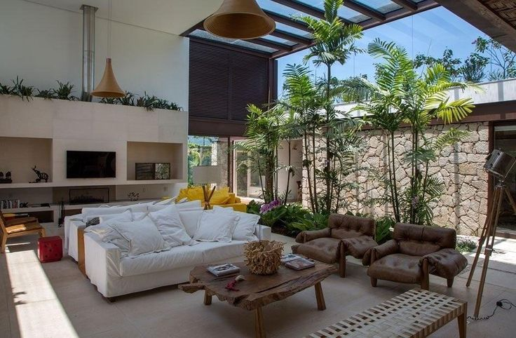 This Gorgeous Living Area Combines Indoor And Outdoor Atmosphereu0027s With The  Tall Trees And Wooden Table