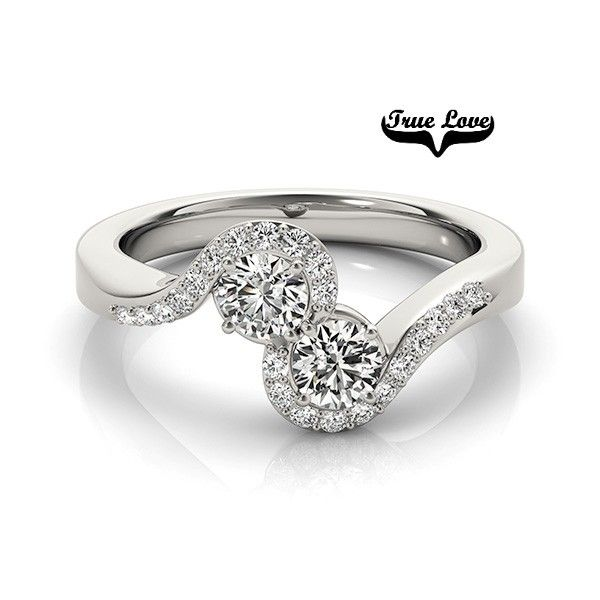 Two stone lovers ring. Set in 14kt white gold, two Forever One Moissanites and diamonds.
